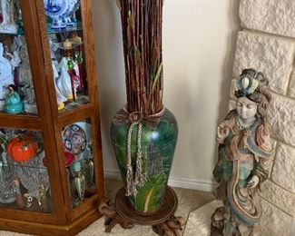 Close up of vase and oriental lady figure
