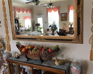Beautiful mirror over sofa table with great large arrangement