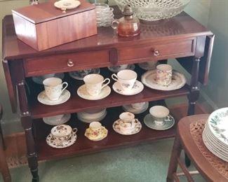 Tea Cart. Collection Tea cups and saucers.