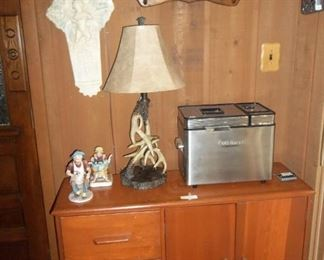 Vintage cupboard/dress with drop leaf in back? Unique. Cuisinart bread machine like new, Antler lamp.