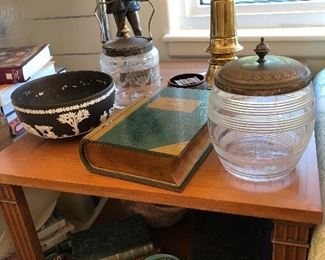 Black Wedgewood Bowl large $40, Crystal jars with silver lids $25 each lamp - stiffel brass $50, Statue metal $ Table $75, leather bound books $15 each