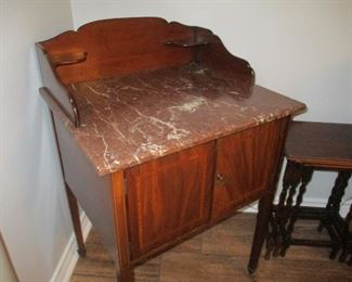 Small English late 19th century rouge veined marble top wash stand.