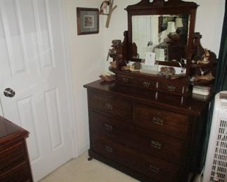English mahogany chest of drawers with mirror back, circa 1880.