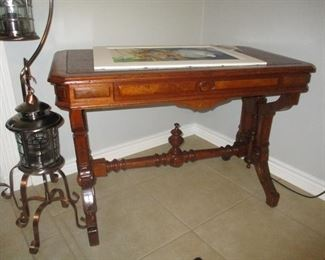 American walnut Renaissance Revival leather top writing table, circa 1870.