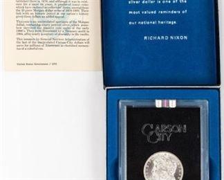 Lot 394 - Coin 1884-CC Morgan Silver Dollar GSA MS64