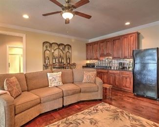 sectional couch has two matching ottomans; rug not included