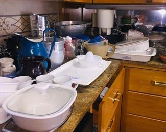 large kitchen filled with cookware