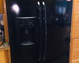 side by side refrigerator with water and ice in the door