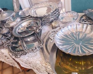 large collection of pewter style serving pieces