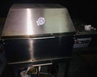 like new stainless steel barbeque pit