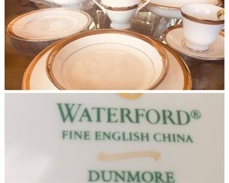 Place setting for 11. Brand new Waterford China with serving pieces.