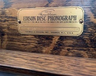"#3	1915 Edison Diamond Disc Phonograph Record Player. Tiger oak cabinet with 79 discs.  It has a needle, the key and it works! 23""x22""x50""	 $600.00"