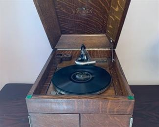 "#4	Victor Talking Machine Victrola in tiger oak cabinet made in 1913. Style number VV-VII 19""x15.5""x13"" It has a needle, one disc and it works!	 $250.00"
