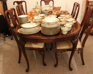 DINING ROOM TABLE AND SIX CHAIRS, 2 ARM CHAIRS AND 4 SIDE CHAIRS.  THE TABLE HAS TWO LEAVES AND A PAD.  MADE BY DIXIE FURNITURE COMPANY