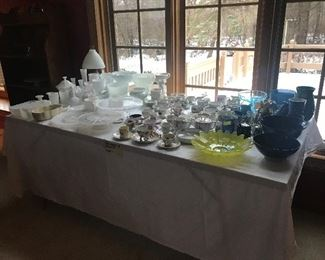 Glassware galore in fantastic condition.  Tea cups/saucers enough for a bridal shower, hobnail White glassware, cake stands, blue glassware etc.,.