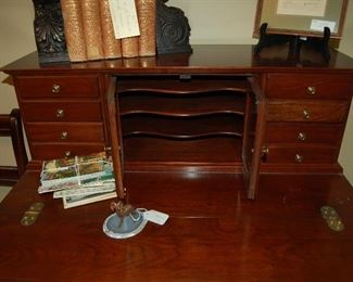 Secretary with slots for stationary