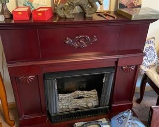 Fireplace, uses Duraflame candles. Not gas or electric