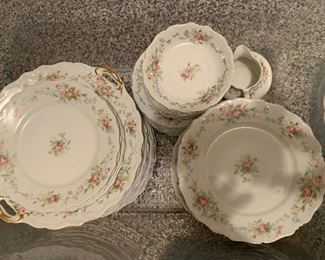 Antique French porcelain set. 12 placesettings and serving pieces.