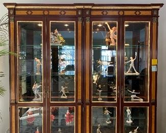 Collectible figurines and stunning curio cabinet that still sells today through designers.