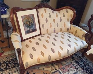Very nice upholstered love seat.