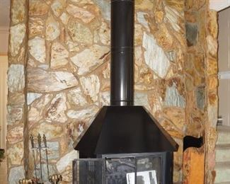 Nice freestanding fireplace with electric insert.  We will be selling it.  It will be removed after the sale and made available for pickup.