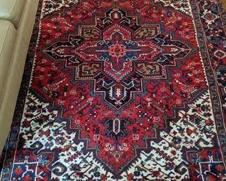 Vintage handwoven Persian Heriz wool rug, measures 10' x 7'.