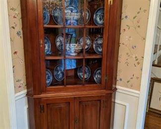 Vintage cherry corner cabinet.