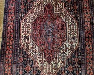 Vintage handwoven Persian Bijar wool rug, measures 4' x 5'.