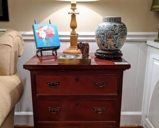 One of a pair of vintage 3-drawer mahogany chests, one of the pair of sienna marble table lamps, one of a pair of snazzy light blue cloisonne urns, original oil on canvas by Atlanta artist and vintage onyx ashtray with brass elephant standing guard of your smoking addiction.