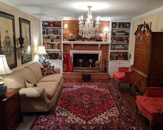Den full of goodies!                                                               Beautiful hand woven Persian Heriz, measuring 7' x 10', pristine down-filled sofa, by Milling Road (the upholstery division of Baker Furn. Co.) pair of vintage mahogany 3-drawer chests, pair of upholstered French bergere chairs, 1940's bird's eye maple high boy, by White Furn. Co., Mebane, NC, pair of nicely framed/matted, hand painted Chinese Ancestors, three pairs of Asian cloisonne vases/urns, antique English brass fire fender, pair of fabby marble table lamps, pair of brass flower andirons, two bookshelves crammed with vintage books and travel souvenirs, all lit by a 6-light cut crystal chandelier.