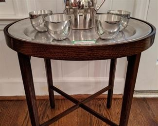 Vintage mahogany tray table, with pewter serving tray.