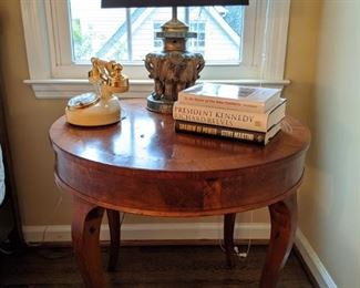 Vintage French walnut side table, with Hollywood agent telephone and 3-elephant elephant lamp.