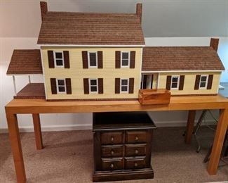 Huge hand made dollhouse on table - this thing took the owner five yers to make and he's very proud of his handwork!