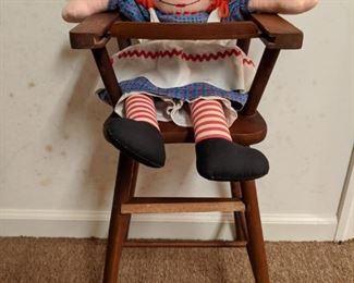 Ain't she cute? Vintage Raggedy Ann doll in child's high chair.