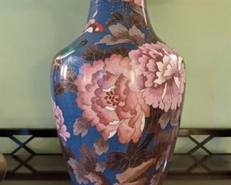 The twin cloisonne table lamps.