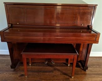 Absolutely pristine 1974 Steinway upright piano, model #45 (signed by Henry Steinway) with matching stool.