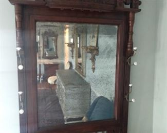 Antique Eastlake wall mirror, with coat/hat rack.