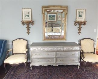 Beautiful, 7-drawer, silver-leafed  dresser, pair of gilt wood wall sconces, pair of framed, antique antique botanical prints and vintage Italian wall mirror.
