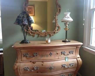 Hand painted Frenchy bombé chest, with matching wall mirror.