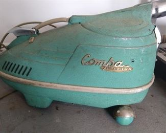 Vintage turquoise vacuum cleaner - very Jetsons!