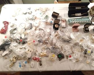 Heaps of good costume jewelry - who knows, we're really dumb and I'm sure there's 14K gold, platinum and sterling items we just didn't see...                                                 ;-)