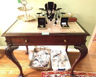 Vintage carved mahogany claw-foot desk (beveled glass top) with single drawer and matching side chair.