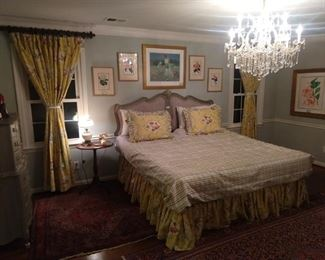 Night time view of the bedroom, with the soft glow of a 13-light, cut crystal chandelier to work it's romantic magic.