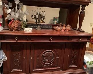 Stunning Carved Figural Buffet/ Sideboard. Excellent piece for a bar.