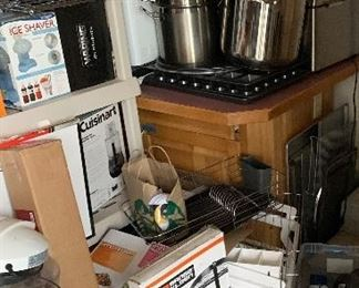 Lots of NIB household items, kitchenware, decorative elements.