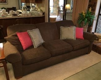 Brown upholstered couch