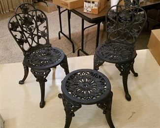 4 cast iron doll chairs and 2 cast-iron doll tables- all unassembled, new in box