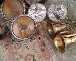 Trippe vintage headlights and brass automobile horns           headlights $100 each, horns $40 each
