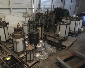 Many chandeliers in bronze and iron to be sold.