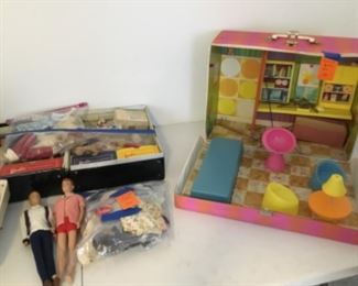 Vintage Barbie & Ken dolls, cases, and accessories.